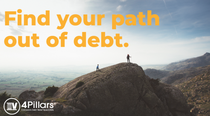 picture of people on a mountain getting out of debt